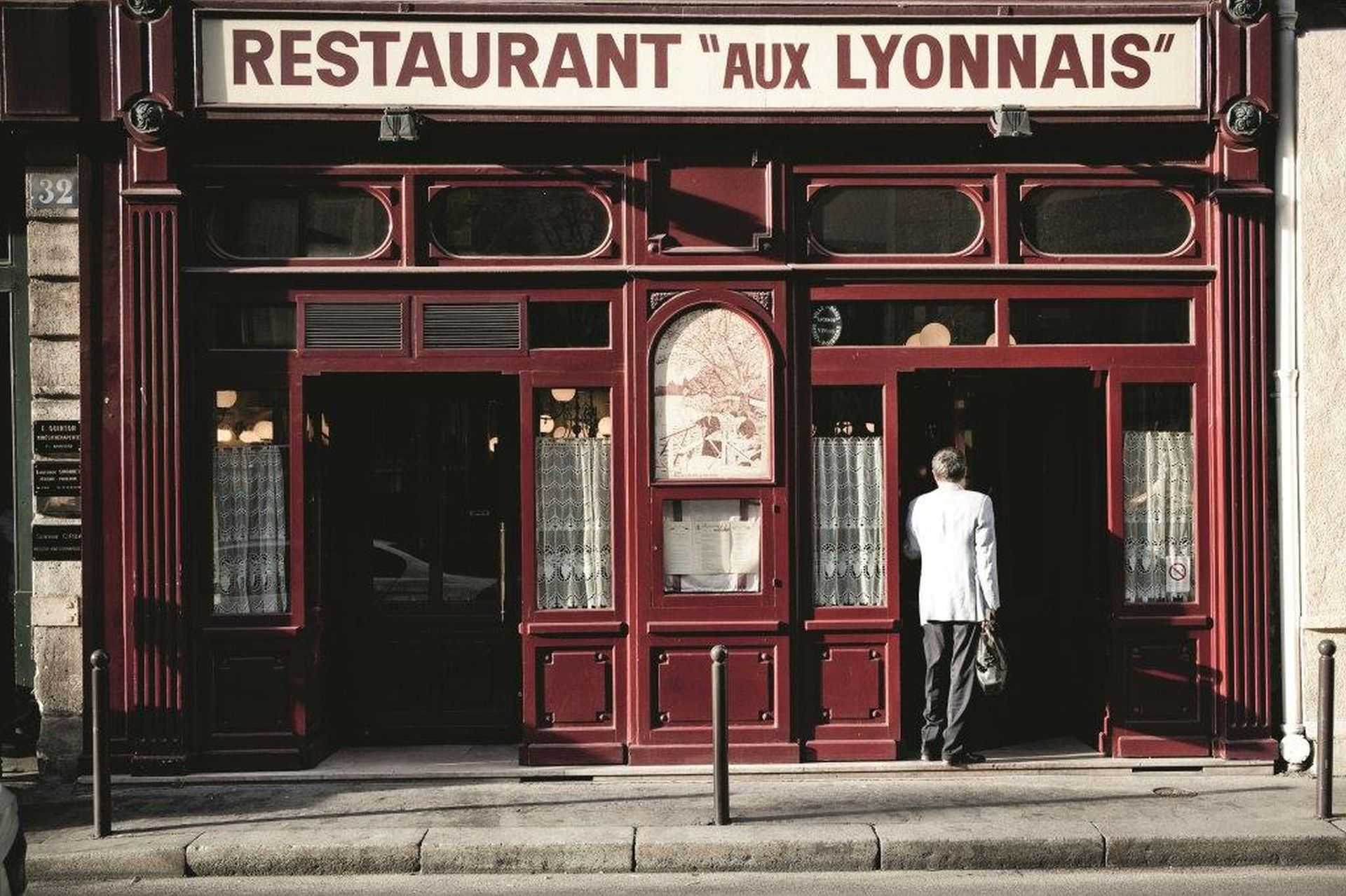 The iconic red wood façade of Aux Lyonnais dates back to 1890, and Ducasse has worked his magic here since 2002 photo © Pierre Monetta